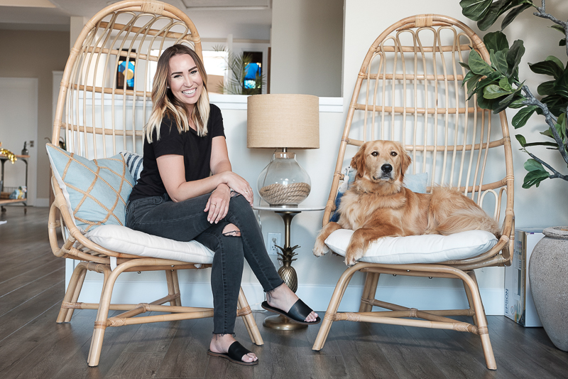 woman and her dog on egg chairs | in-home lifestyle dog photography ©Nicole Caldwell Photo