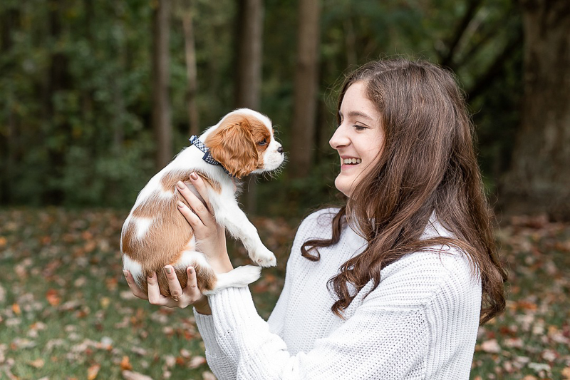 young woman holding small puppy, King Charles Cavalier Spaniel pup | Heather O'Steen Photography | pet photographer in the DC area