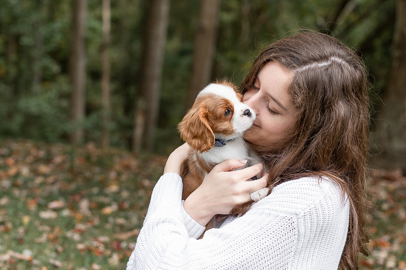 on location fall portrait ideas, college student snuggling with her puppy, senior portrait ideas | Heather O'Steen Photography