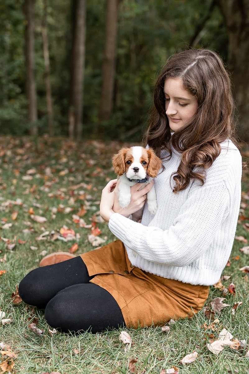 college student holding small King Charles Cavalier Spaniel puppy, fall pet photography ideas | Heather O'Steen Photography, Washington DC and surrounding area portraits