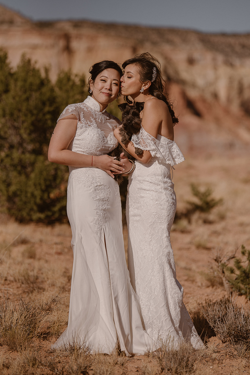 two brides and their dog, LGBTQ elopement in Taos, NM | © Adventure Instead elopement photography | Abiquiú, MN and worldwide