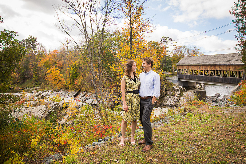 couple in front of covered bridge, New England engagement ideas | ©Cat Cutillo Photography
