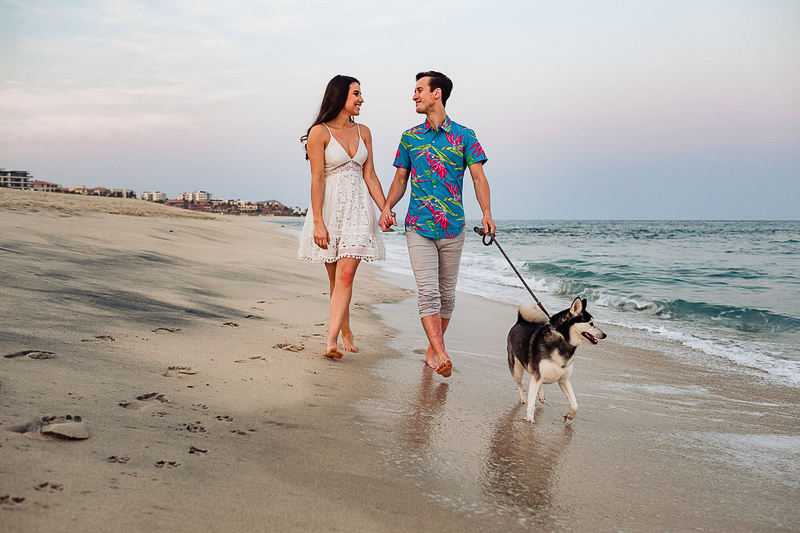 couple and their dog walking on the beach, ©Fabi Rosas Photography, dog-friendly engagement session Cabo, Mexico