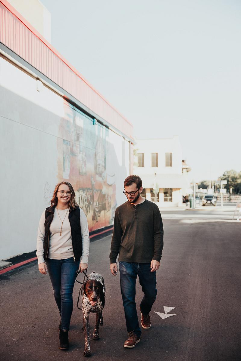 couple walking their dog downtown | Joshua and Parisa | Austin Wedding Photographer and Videographer