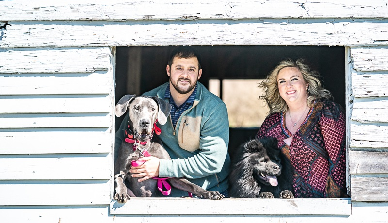 couple and their dogs looking out of shed window | Nada Khalaf-Jones Skyborn Visual Studios