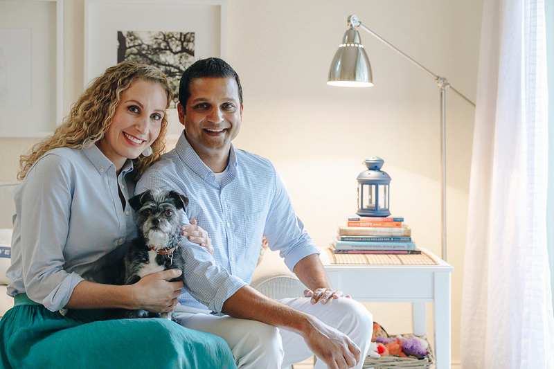 couple and their Shih-Tzu mix, in home photography session | ©Charleston Photo Art