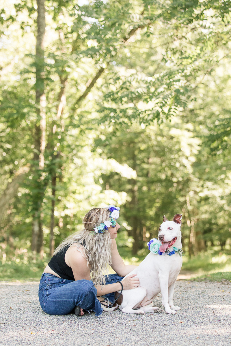 a girl and her dog sitting on gravel path, on location pet portraits | ©Limelight Entertainment