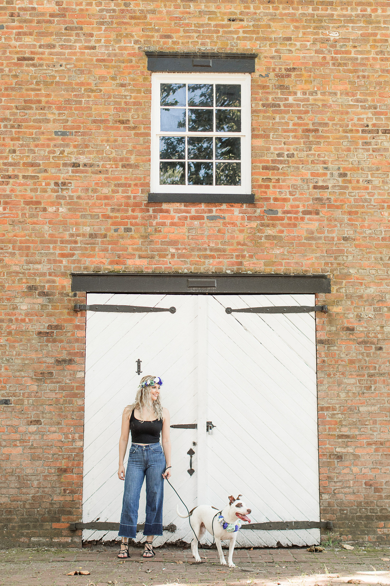 mixed breed and woman in front of brick building with white carriage house doors, ©Limelight Entertainment