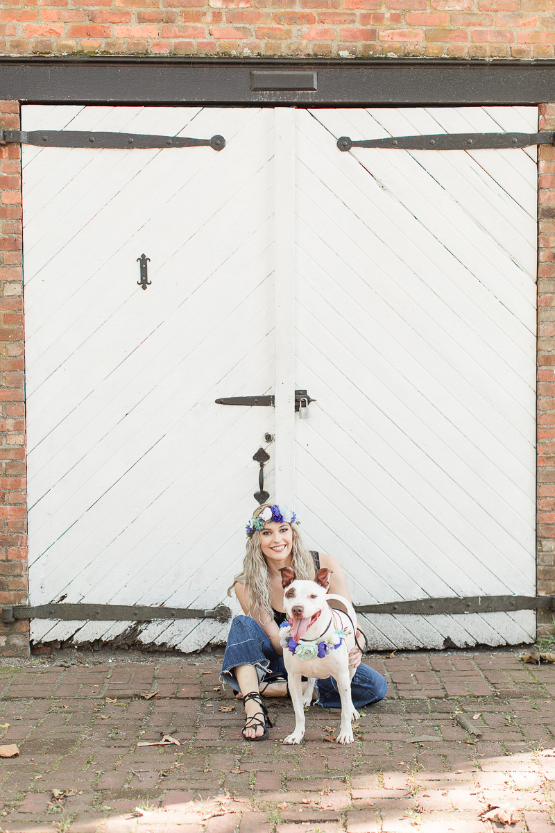 woman and mixed breed in front of carriage house, on location pets and people portraits, Allaire State Park | ©Limelight Entertainment