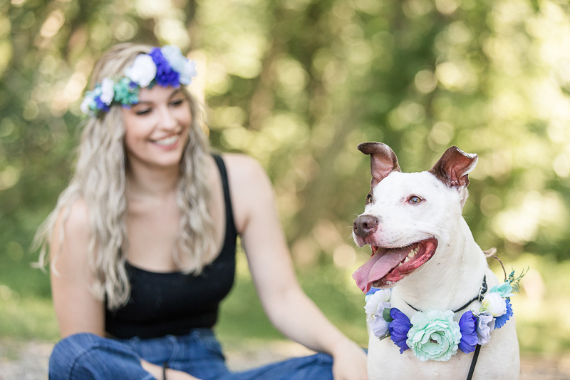 dog photography ideas, cute mixed breed and woman wearing matching floral wreaths | ©Limelight Entertainment