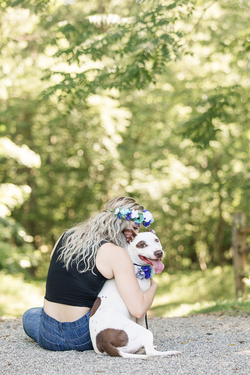 woman hugging dog, dog looking at camera | ©Limelight Entertainment | pet-friendly portrait session
