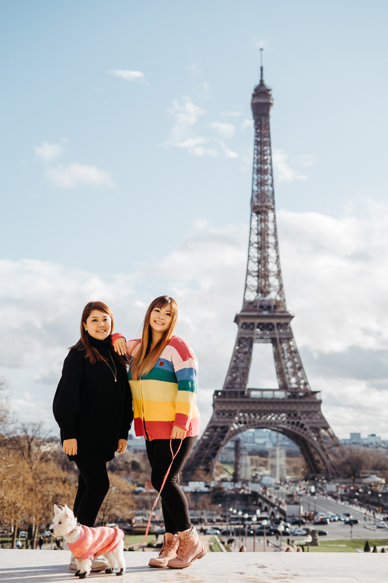 two women and their dog posing by Eiffel Tower | Février Photography | dog-friendly portraits in Paris, France