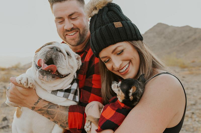 couple holding their dogs, Buffalo Plaid themed photos Ali Tso Photography, dog-friendly lifestyle photography
