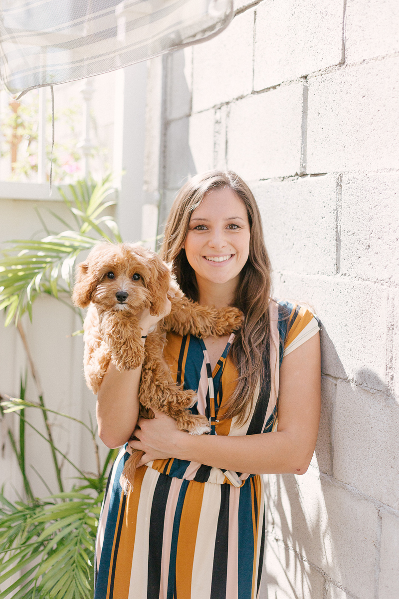 woman holding her dog, pet-friendly lifestyle photography | ©Jasmine Marie Photography