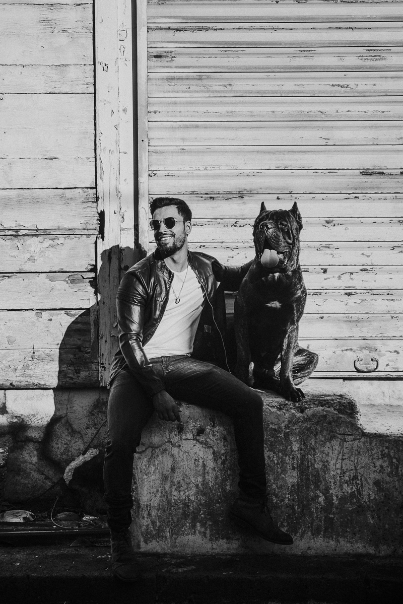 man and his dog, Cane Corso and man sitting on concrete, Cedric D Vincent Photography | Mauritius fashion photographer