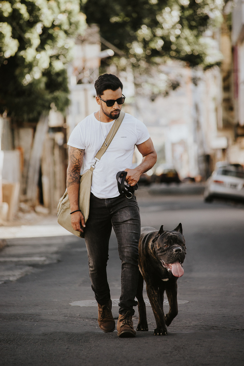 man and Cane Corso walking in the street, Cedric D Vincent Photography | Mauritius fashion photographer