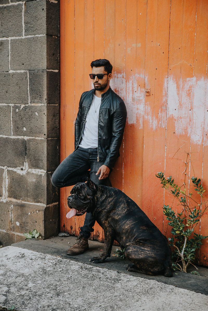 man and dog leaning against orange garage doors | Cedric D Vincent Photography | Mauritius lifestyle photographer