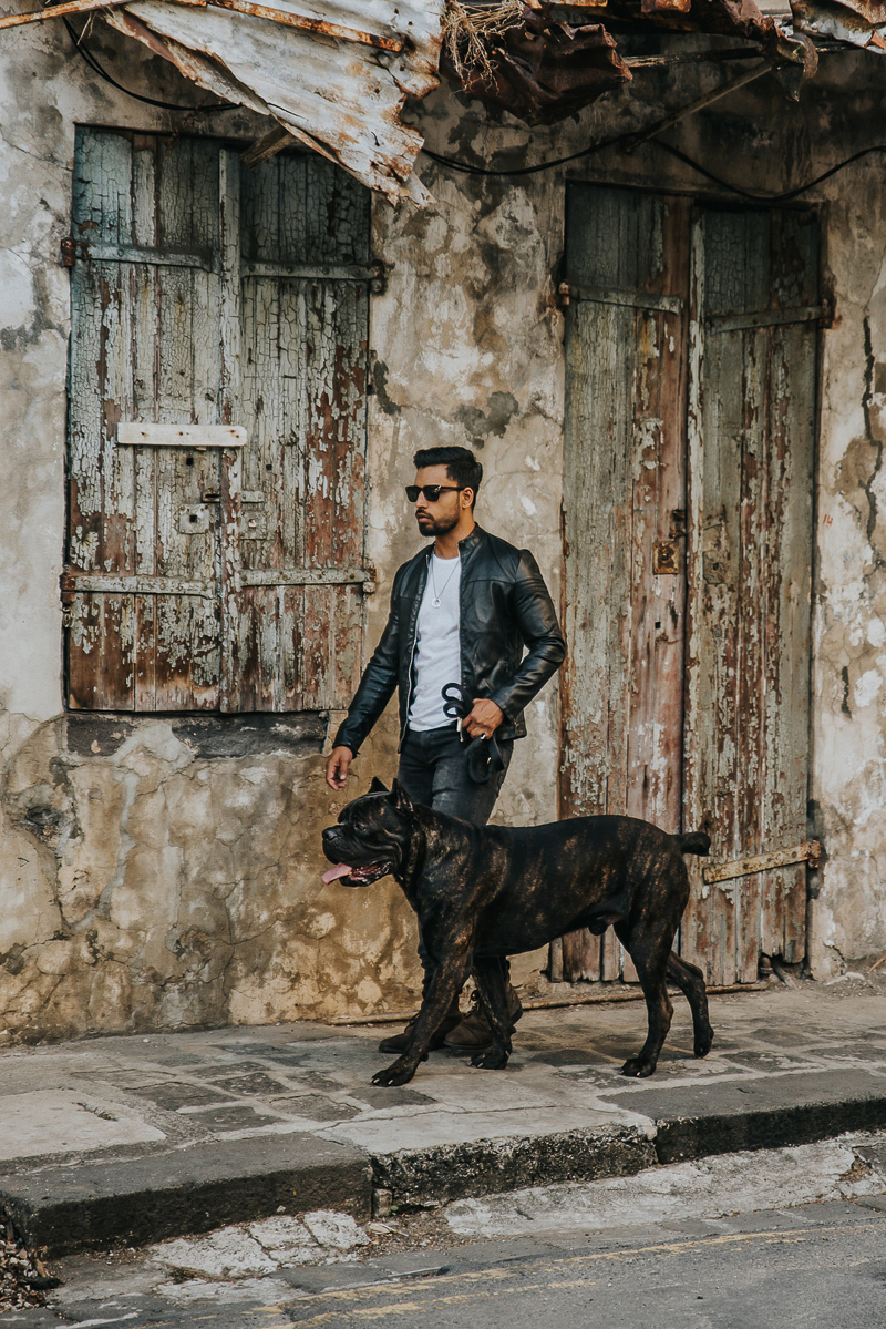 man in sunglasses and black leather jacket walking handsome dog | Cedric D Vincent Photography | Mauritius fashion photographer