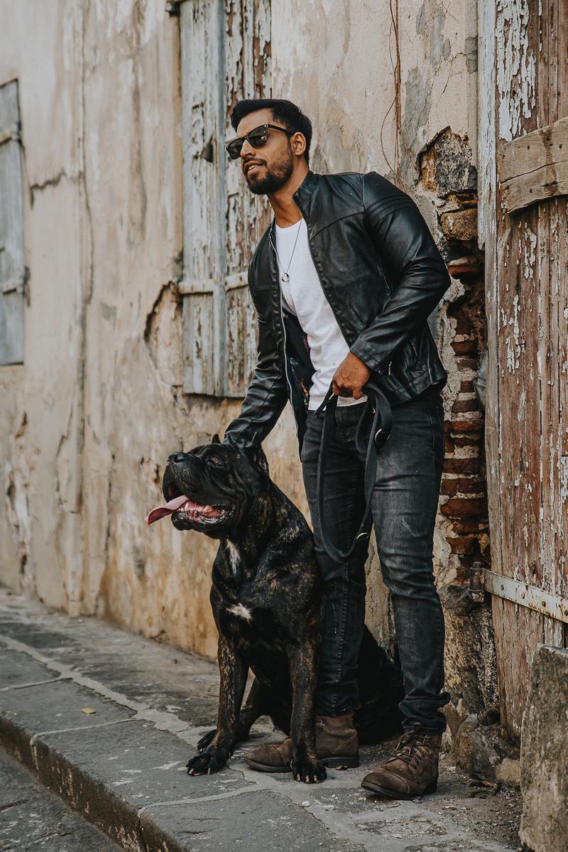 man in black jacket petting Cane Corso | Cedric D Vincent Photography | Mauritius fashion photographer