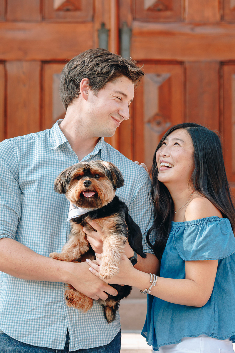 engagement portraits with a dog, small dog photography poses, ©Charleston Photo Art