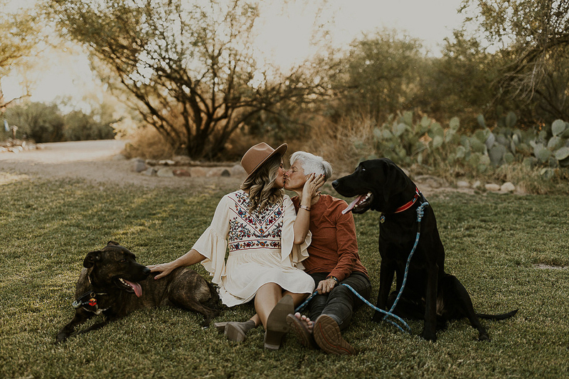 women kissing, dogs sitting next to them, dog-friendly engagement session | ©Kali M Photos |