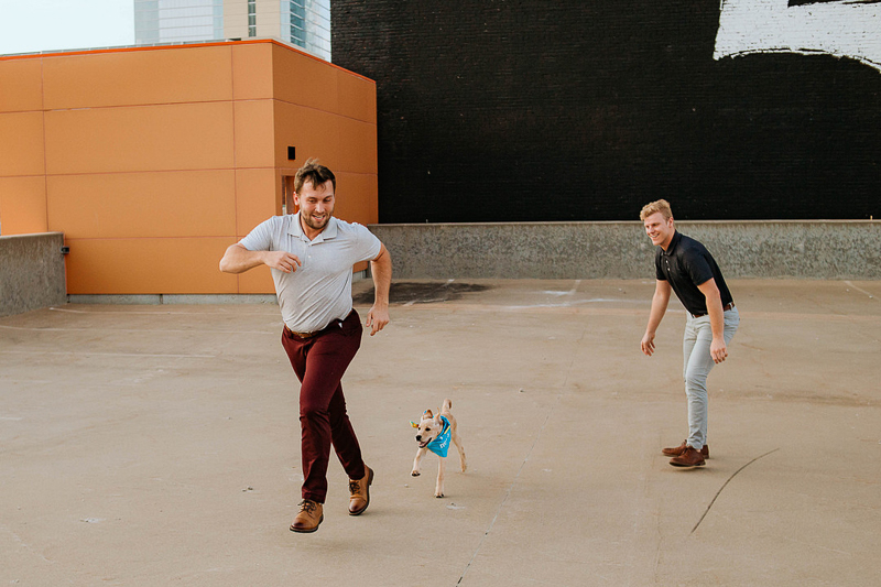 man running with puppy following behind, fun same sex couple photography session, ©Stevie Nicole Photography