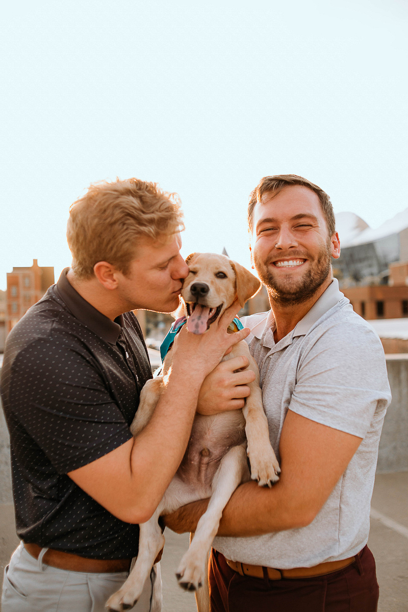 happy couple and their puppy on parking garage roof, KC | ©Stevie Nicole Photography