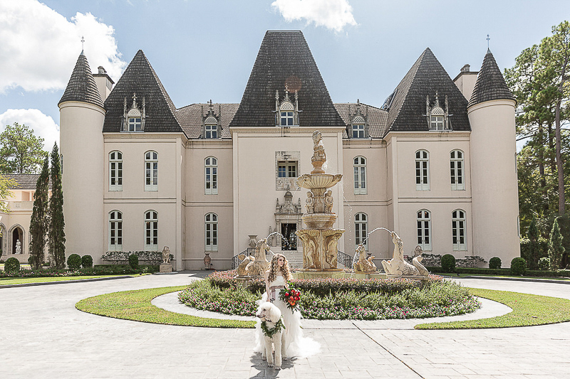 bride and poodle standing outside Chateau Cocomar | ©C. Baron Photography | dog-friendly bridal shoot, Houston, TX