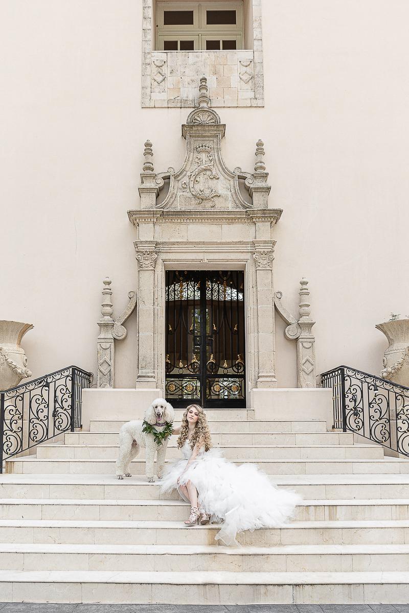 bride and dog outside Chateau Cocomar, Houston, TX | ©C. Baron Photography