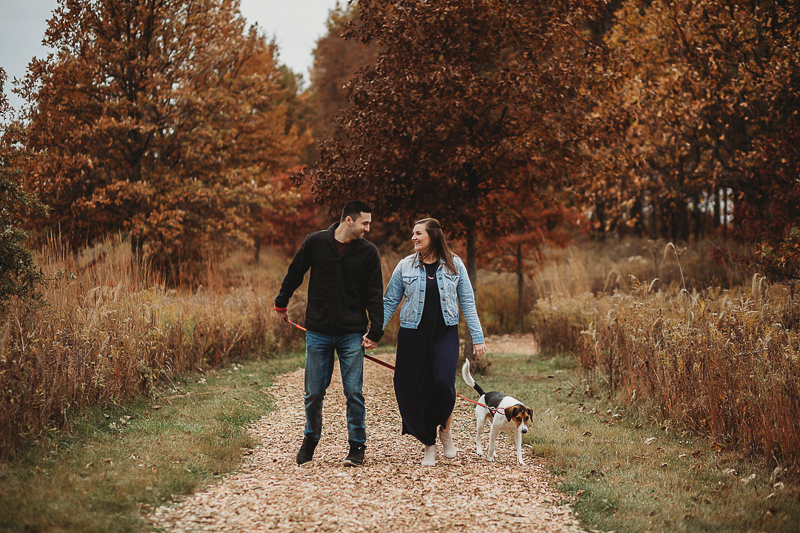 couple walking their dog while holding hands, fall photography ideas, ©Samantha Mitchell Photography | dog-friendly session