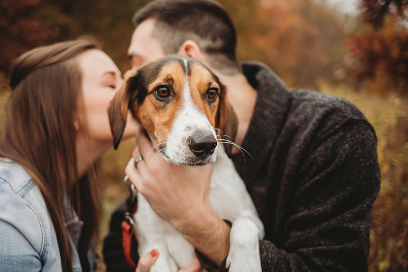 couple kissing while holding their dog, ©Samantha Mitchell Photography | dog-friendly engagement ideas