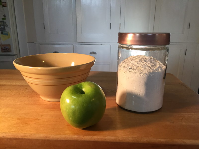 apple, bowl, and flour on counter, 2 ingredient dog treats | Daily Dog Tag