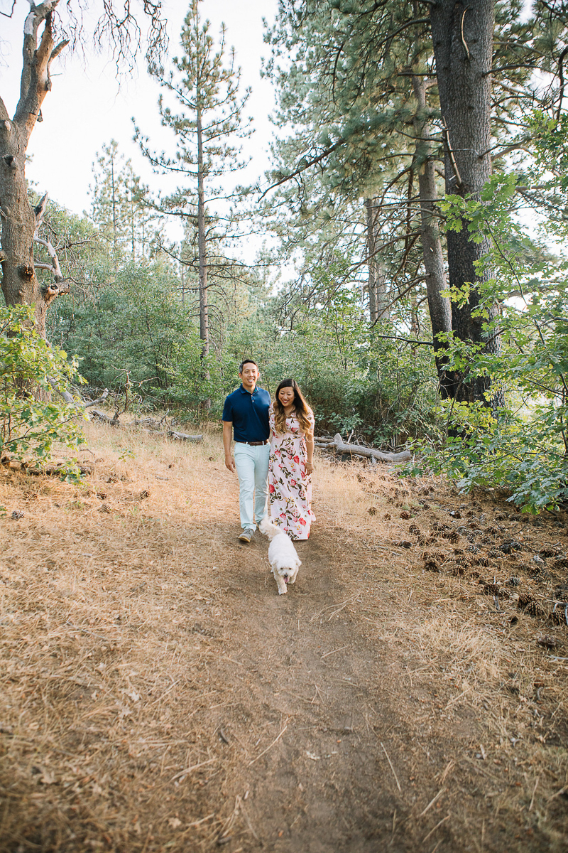 couple and small white dog walking on trail, dog-friendly engagement Lake Cuyamaca | ©Stephanie Fong Photography