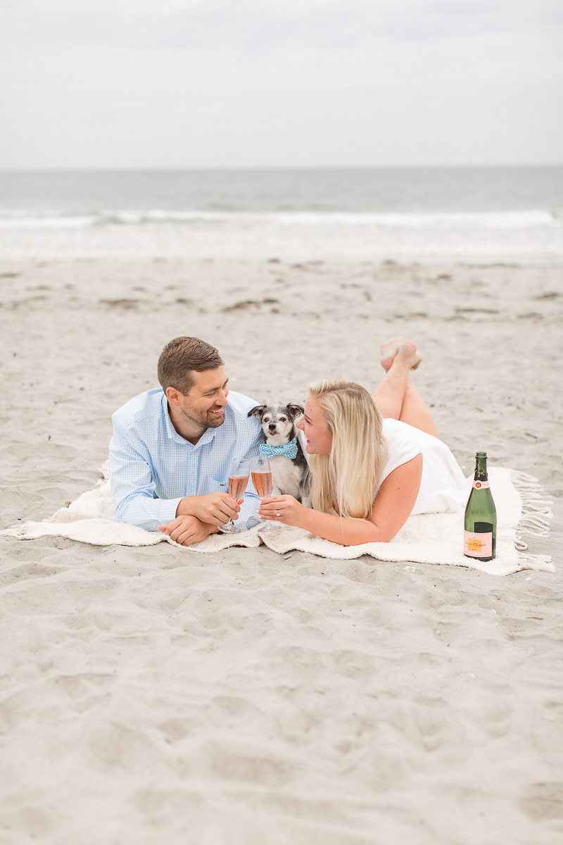 couple drinking a toast on the blanket at the beach, Newport, RI