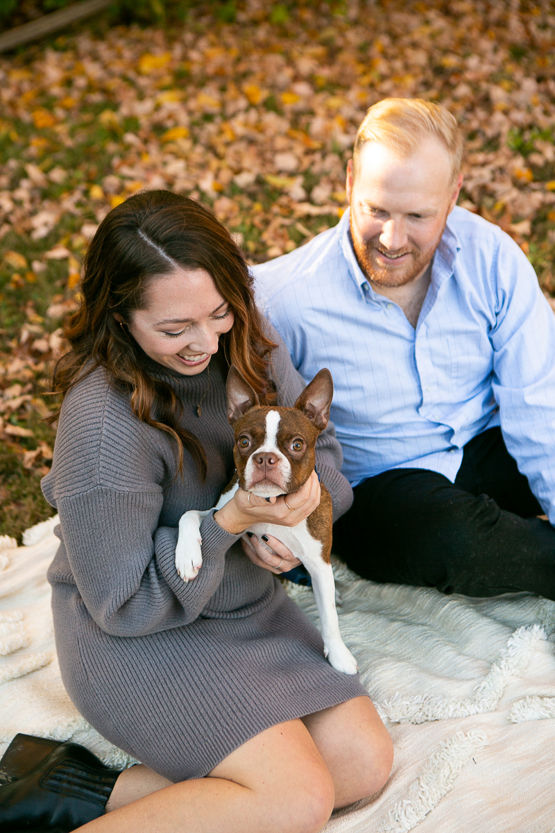 couple sitting on blanket, Boston Terrier in woman's lap, fall photography ideas   ©Mandy Whitley Photography