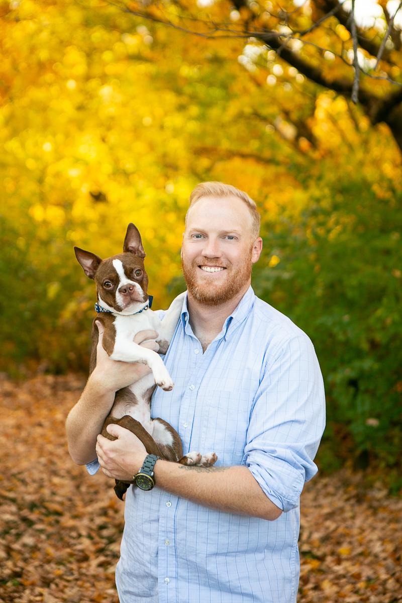 fall family portrait ideas, man holding Boston Terrier, perfect autumn day   ©Mandy Whitley Photography, Nashville, TN