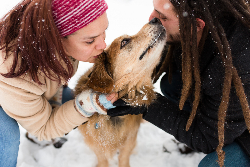 couple kissing their dog, snowy dog-friendly portraits | ©Megan Rei Photography | Bealeton, VA
