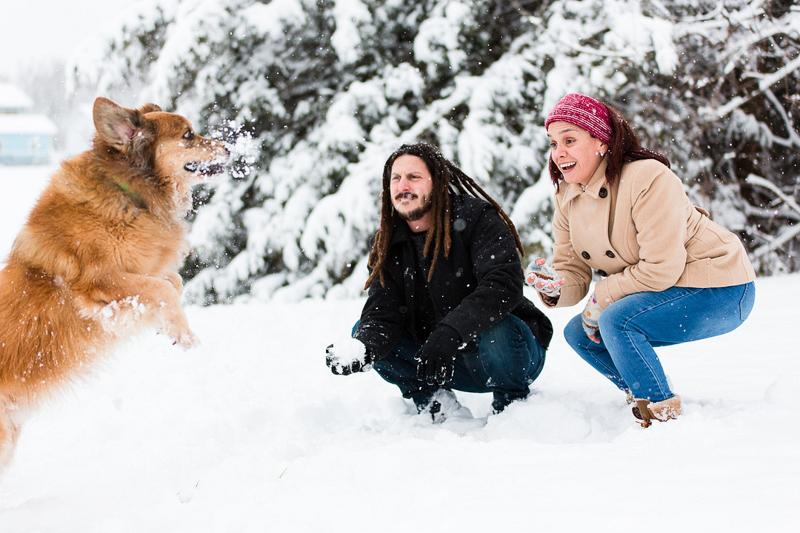 dog catching snowball, snowy family portraits | ©Megan Rei Photography | Bealeton, VA