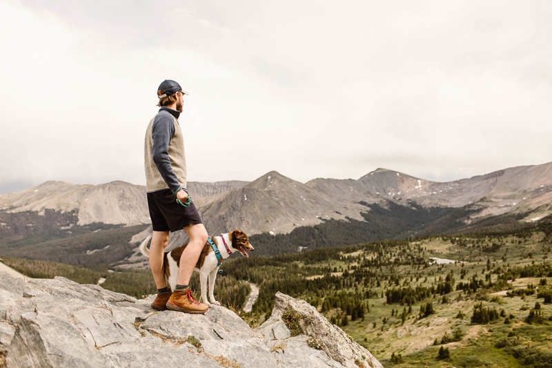 man and dog standing on overlook | ©Sheena Shahangian Photography | Adventure Elopement Photography