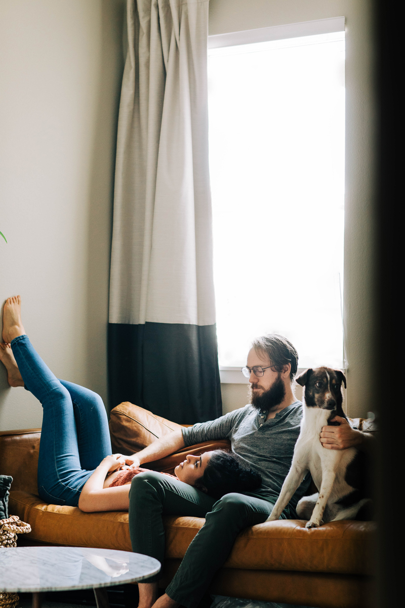 couple relaxing on sofa with their dog, lifestyle dog photography ideas | ©Sheena Shahangian Photography