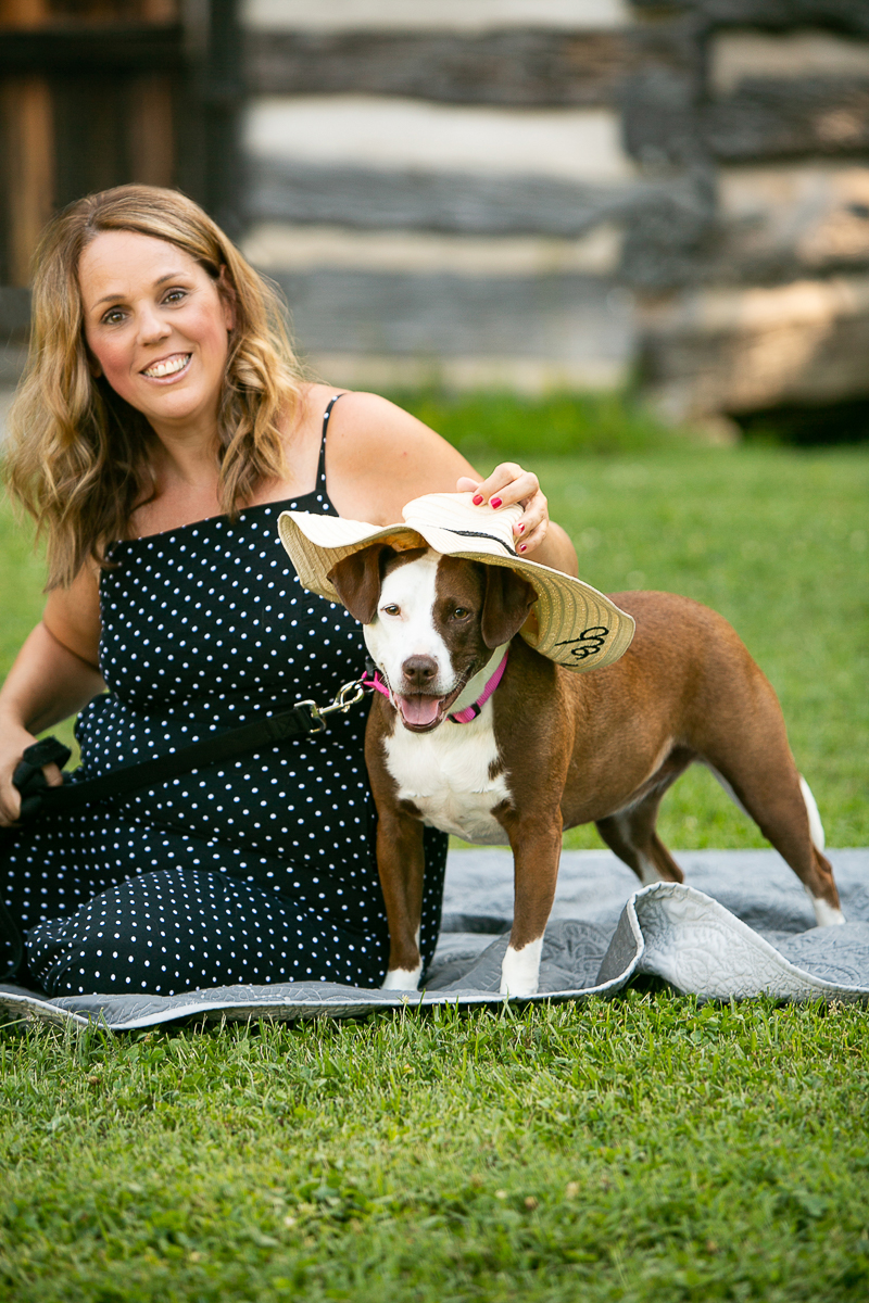 woman and her dog, dog wearing straw hat, dog photography ideas | ©Mandy Whitley Photography