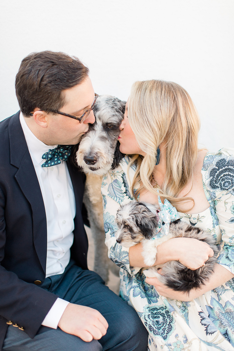 couple kissing Aussiedoodle, woman holding another Aussiedoodle puppy, dog-friendly family photos | ©Christa Rene Photography