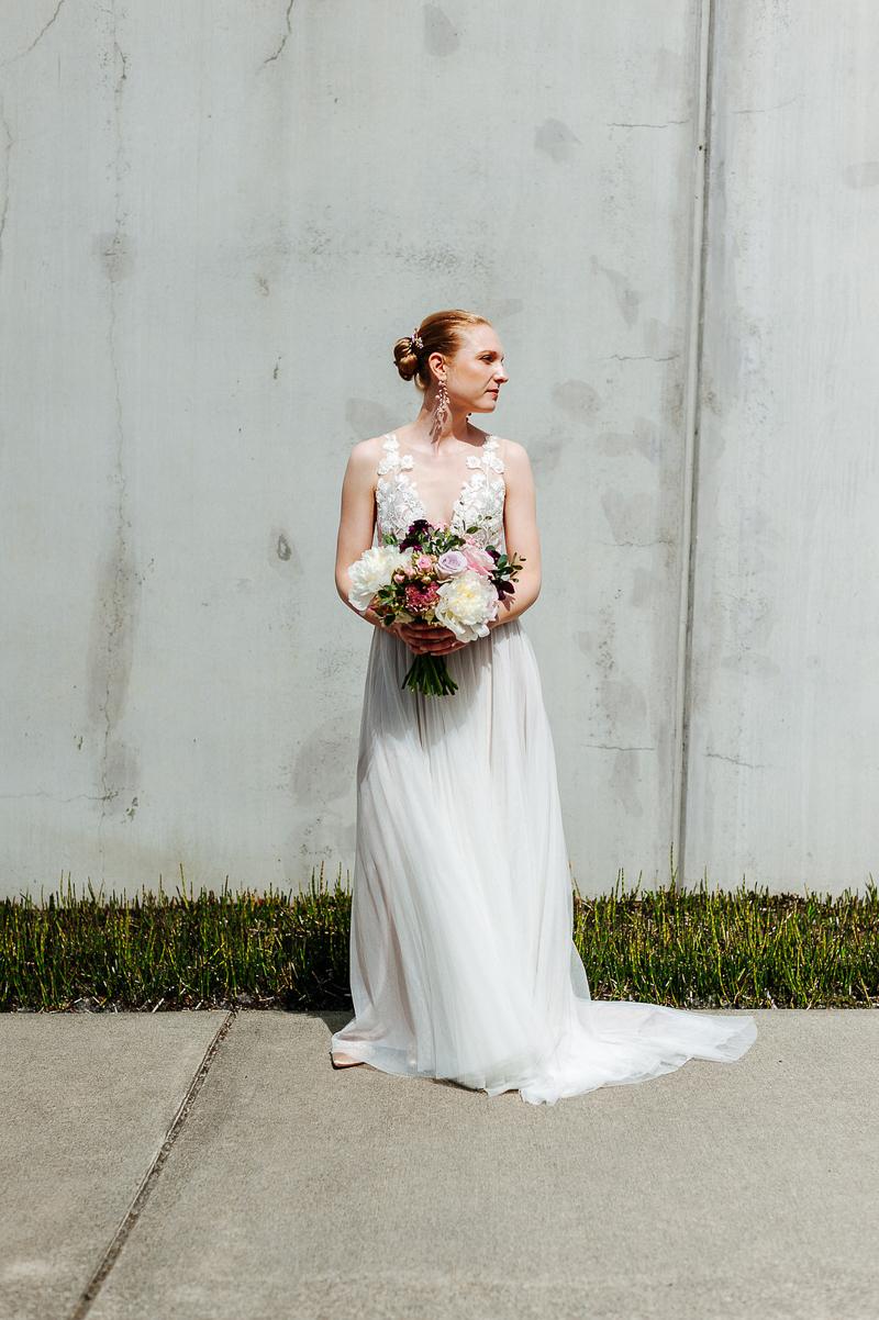 bride holding bouquet, ©J Tobiason Photography   Novelty Hill-Januik Winery