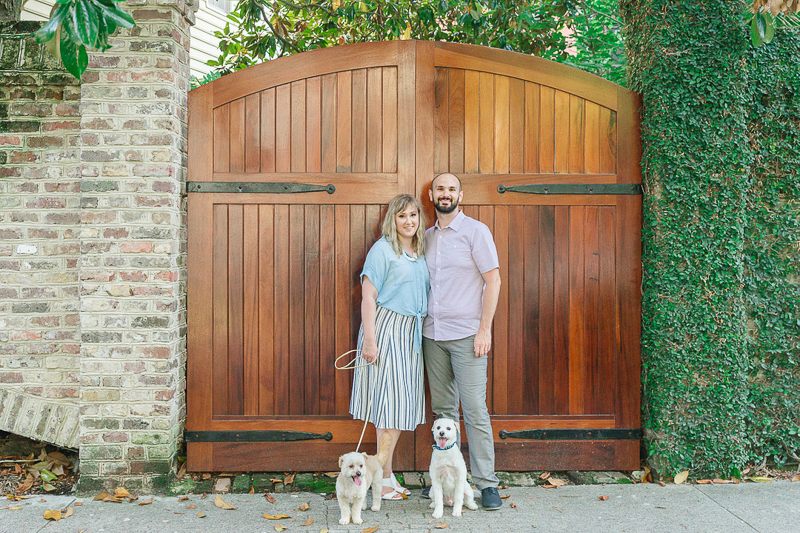 couple and their dogs in front of arched wood gate, ©Charleston Photo Art, dog-friendly family portraits