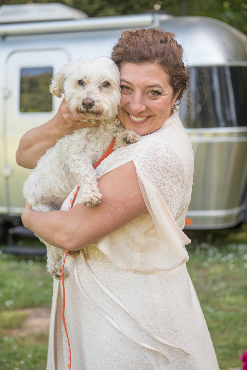 bride in long dress holding white dog, Rustically Romantic Photography by Darby Johnson