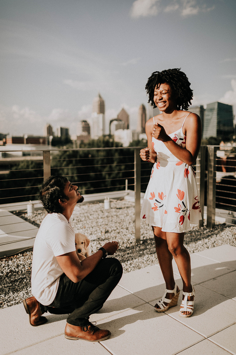 man on one knee with puppy proposing to young woman, ©Sheena Shahangian Photography
