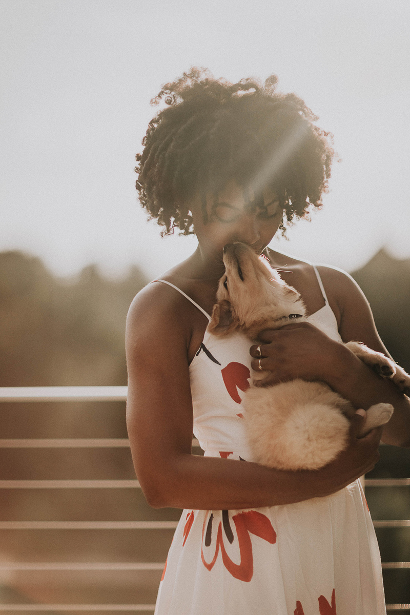 woman snuggling with young puppy | ©Sheena Shahangian Photography