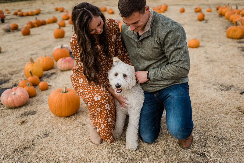 fall photo ideas, couple and their dog in pumpkin patch   ©Erica Jane Photography   Sioux Falls, SD